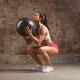 sportswoman doing dead lift exercise with medball - PhotoDune Item for Sale