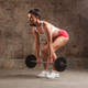 sportswoman doing dead lift exercise with barbell - PhotoDune Item for Sale