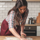 young woman housewife cooking cookies in kitchen - PhotoDune Item for Sale