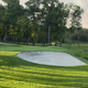Panorama of a golf green and bridge in late afternoon sunlight - PhotoDune Item for Sale