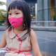 Asian little girl resting on the street with a mask - PhotoDune Item for Sale