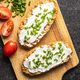 Crispbread with creamy cheese., green chive and tomatoes - PhotoDune Item for Sale