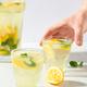 Two Glasses of Lemonade on White Table. - PhotoDune Item for Sale