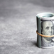 Roll of One Hundred American Dollars. - PhotoDune Item for Sale