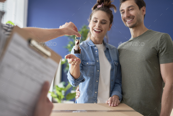 Couple finally getting home keys - Stock Photo - Images
