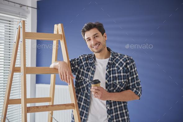 Portrait of handyman having a coffee break - Stock Photo - Images