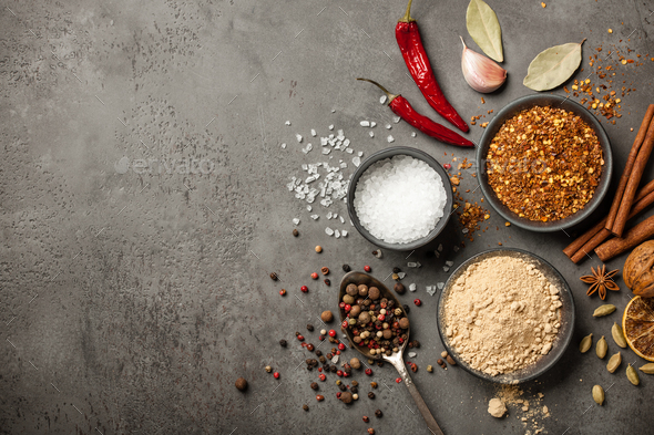 Various spices for cooking on stone background - Stock Photo - Images