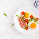 English breakfast - fried eggs, sausages, tomatoes and arugula - PhotoDune Item for Sale