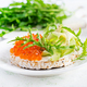 Crispbread sandwiches with red caviar, avocado and cream cheese  in plate. - PhotoDune Item for Sale