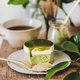 Green matcha cheesecake and coffee in mug on kitchen counter - PhotoDune Item for Sale