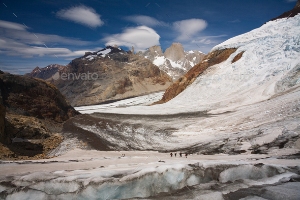 Several hikers on a glacier and Fitz Roy mountain in the background, Argentina - Stock Photo - Images