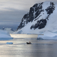 People in small inflatable zodiac rib boats passing icebergs and ice floes in Antarctica - PhotoDune Item for Sale