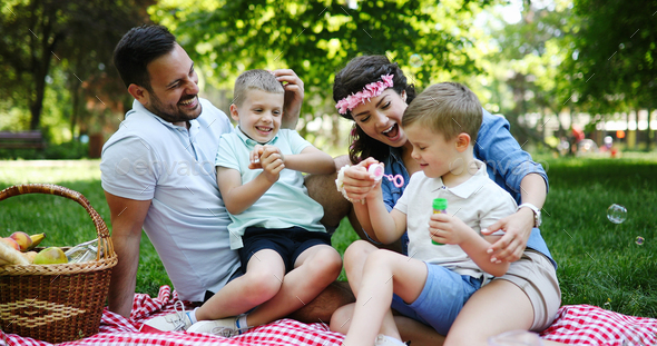 Family picnic outdoors togetherness relaxation happiness concept - Stock Photo - Images