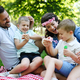 Family picnic outdoors togetherness relaxation happiness concept - PhotoDune Item for Sale