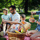 Cheerful happy family picnicking on a beautiful day - PhotoDune Item for Sale