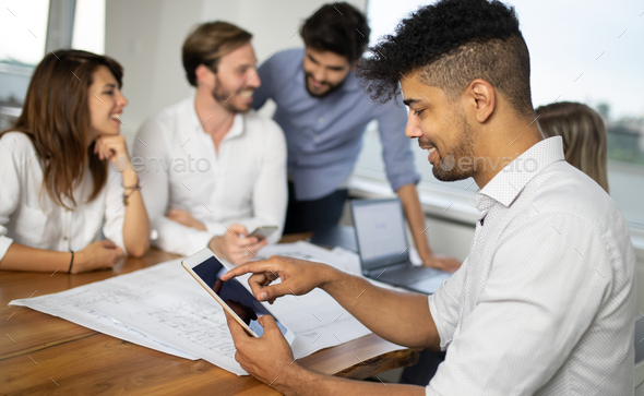Entrepreneurs and business people working together in office - Stock Photo - Images