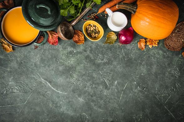 Pumpkin soup on green vintage background - Stock Photo - Images