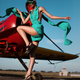Fashion pilot girl in a visor posing next to propeller plane at runway during sunset - PhotoDune Item for Sale
