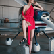 Fashion photo of model girl in red dress posing with jerrycan next to propeller plane in the garage - PhotoDune Item for Sale