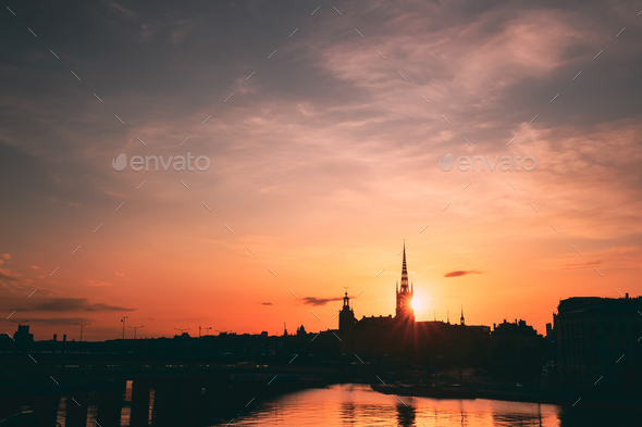 Stockholm, Sweden. Sunset Sun Shine Through Dark Silhouette Of Riddarholm Church In Stockholm - Stock Photo - Images