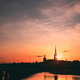 Stockholm, Sweden. Sunset Sun Shine Through Dark Silhouette Of Riddarholm Church In Stockholm - PhotoDune Item for Sale