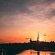 Stockholm, Sweden. Sunset Sun Shine Through Dark Silhouette Of Riddarholm Church In Stockholm - PhotoDune Item for Sale