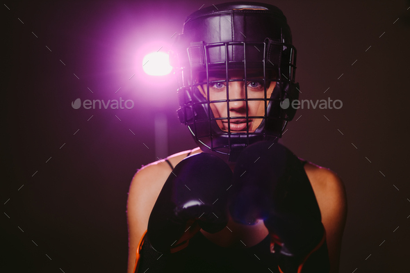 sexy woman fighter in boxing gloves and headgear portrait - Stock Photo - Images