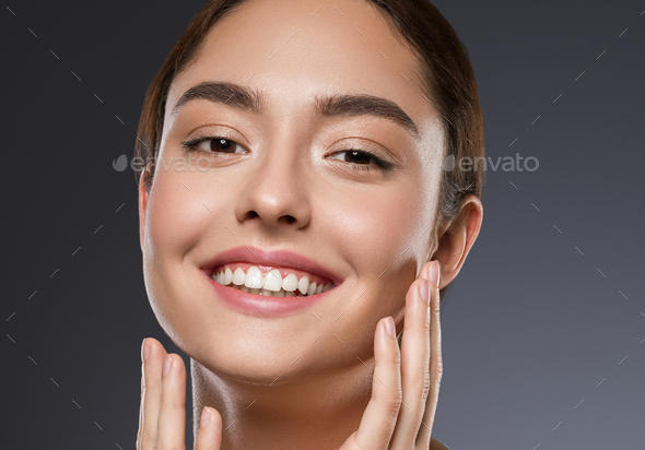 Woman smile fashion make up tanned skin beautiful smile clean skin natural make up dark background - Stock Photo - Images