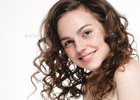 Beautiful face woman freckles and curly fly hair - Stock Photo - Images