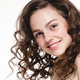 Beautiful face woman freckles and curly fly hair - PhotoDune Item for Sale