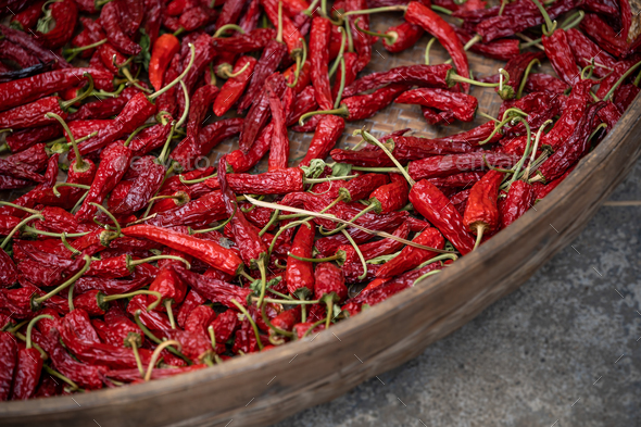 Chili drying in a wicker bowl - Stock Photo - Images