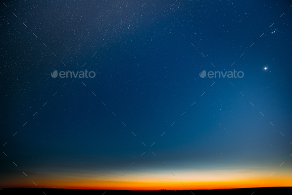 Night Starry Sky With Glowing Stars Above Countryside Field Landscape In Early Spring. Bright Glow - Stock Photo - Images