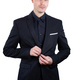Young elegant man buttoning his jacket on a white background - PhotoDune Item for Sale