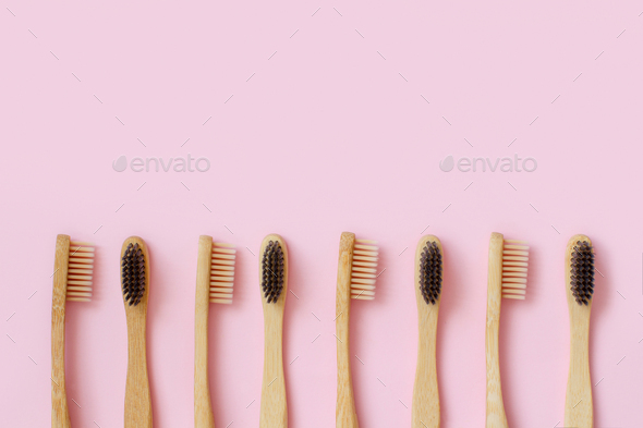 Eco friendly bamboo toothbrushes on pink background - Stock Photo - Images