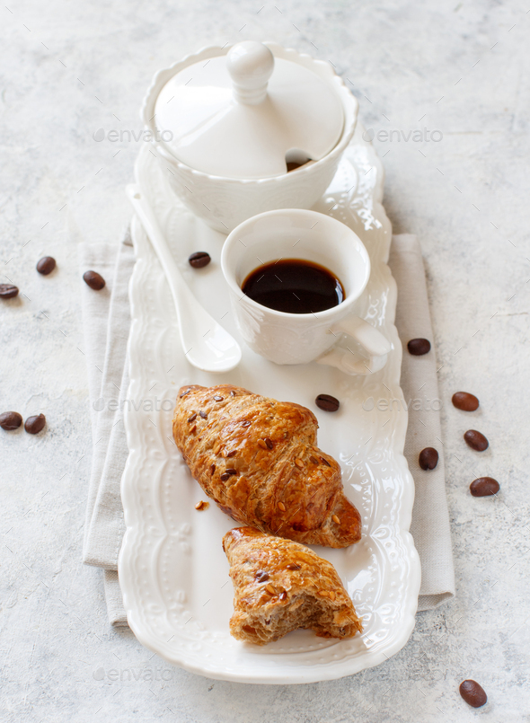 Breakfast tray with coffee cup and croissant - Stock Photo - Images