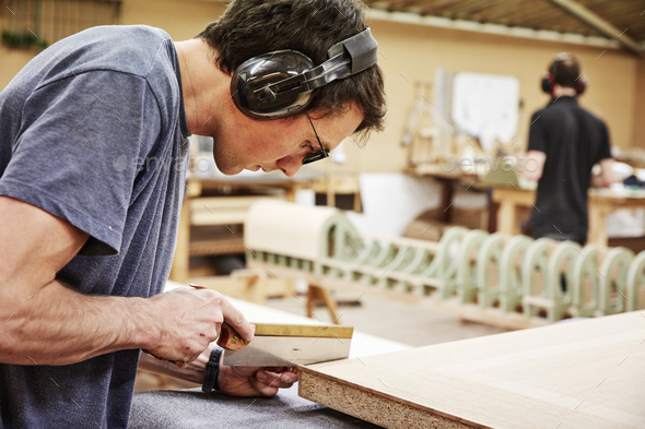 Man making wood furniture - Stock Photo - Images