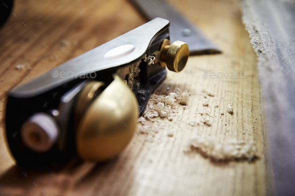 A wood plane with smooth handle and wood shavings. - Stock Photo - Images
