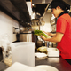 The ramen noodle shop. A chef working in a kitchen preparing food using a stove and large pans. - PhotoDune Item for Sale