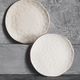 Gray empty plates (ceramic) on a gray stone background. Gray minimalism concept - PhotoDune Item for Sale