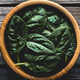 Spinach leaves in a wooden plate. on the old background. Vegan, wholesome foods - PhotoDune Item for Sale