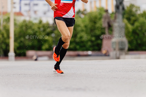 man runner in black compression socks - Stock Photo - Images