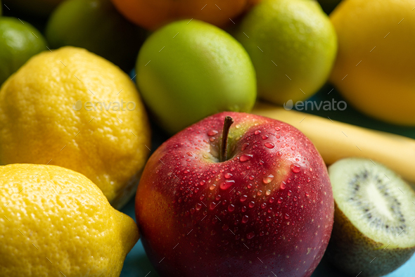 Close up View of Wet Red Apple Near Fruits - Stock Photo - Images