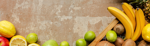 Top View of Ripe Summer Fruits in Wooden Box And on Weathered Beige Surface, Panoramic Crop - Stock Photo - Images