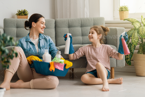 family cleaning the room - Stock Photo - Images