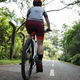 Woman riding on bike path at park on sunny day - PhotoDune Item for Sale