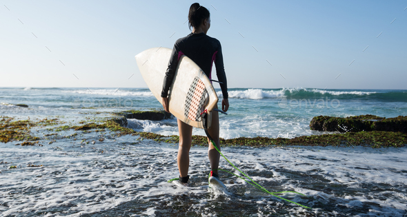 Surfer going to surf - Stock Photo - Images