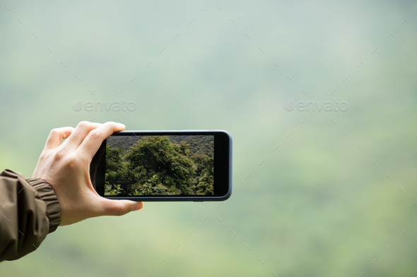 Taking picture with mobile phone in spring nature - Stock Photo - Images