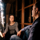guy and a girl lit sparklers inside a wooden house - PhotoDune Item for Sale