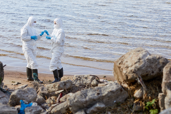 Ecologists taking samples of water - Stock Photo - Images