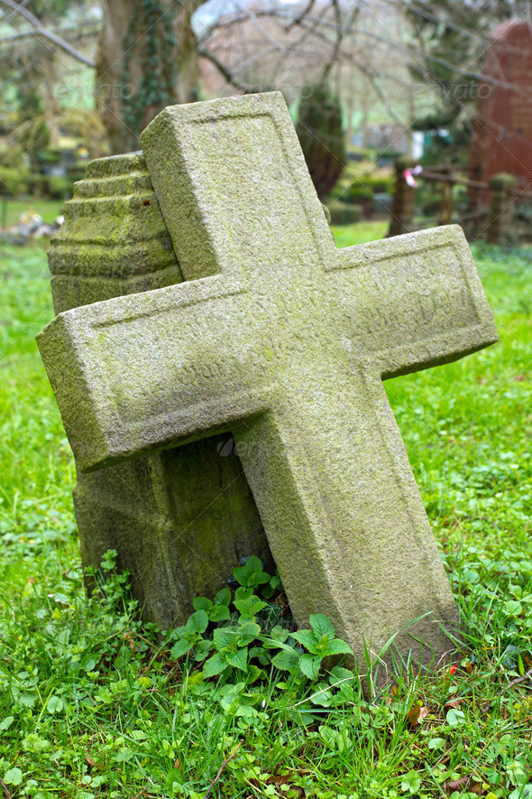 Cross on a cemetary - Stock Photo - Images